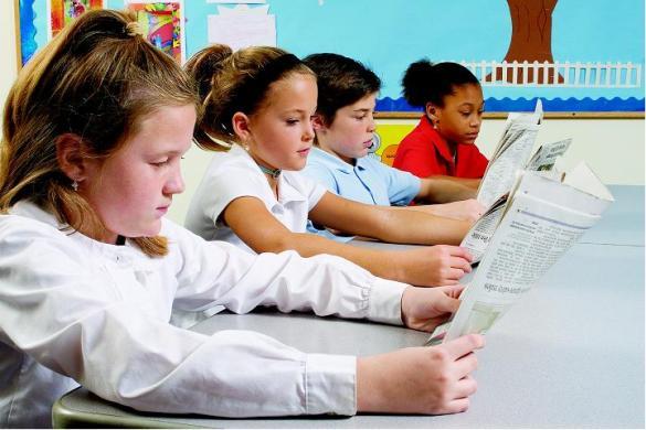 kids-reading-paper